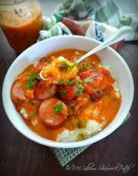 Grits with Andouille Sausage and Cajun-Style Red Gravy