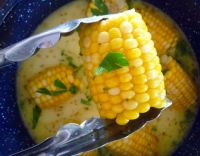 This recipe for Southern Milk and Honey Corn on The Cob will be one of the best corn on the cob recipes you will have ever try this season hands down; made with delicious Florida sweet corn, simmered slowly in whole milk, organic honey, unsalted butter, and seasoned to perfection with Cajun spices, kosher salt, and freshly ground peppercorns. So darn good you won't even bother with extra butter or salt.