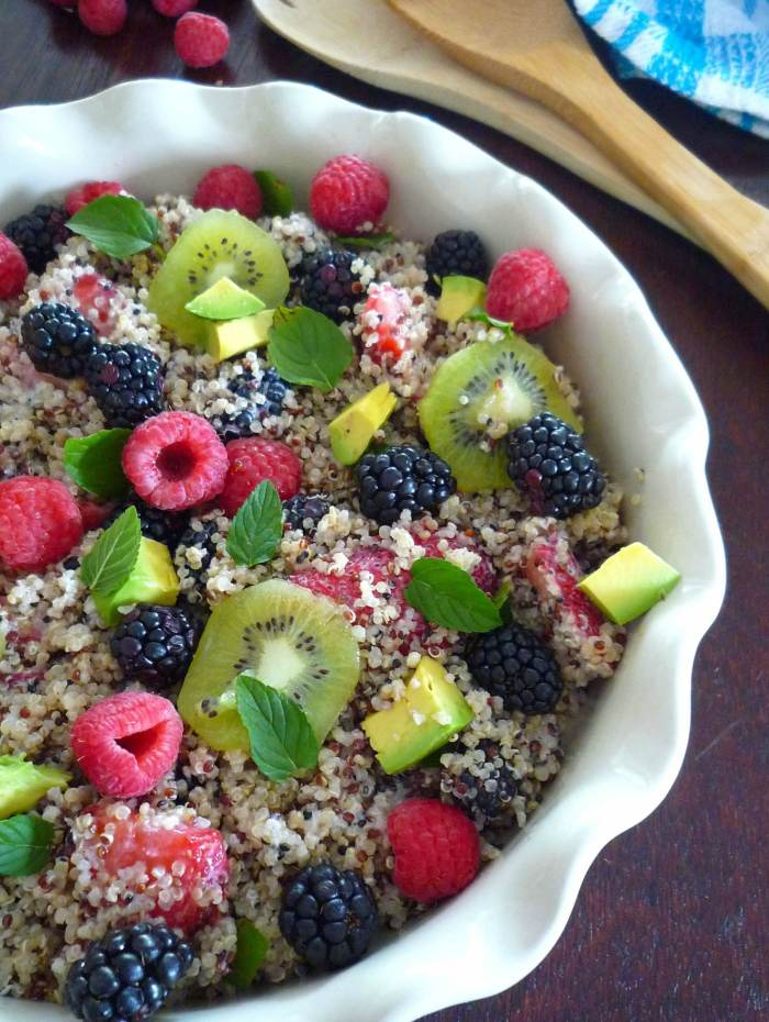 Healthy Fruit and Quinoa Salad with Yogurt Dressing is a perfectly healthy, colorful, spring salad that combines tricolor organic quinoa, fresh organic fruit such as raspberries, blackberries, strawberries, kiwi, Hass avocados, mint leaves and creamy delicious yogurt dressing.