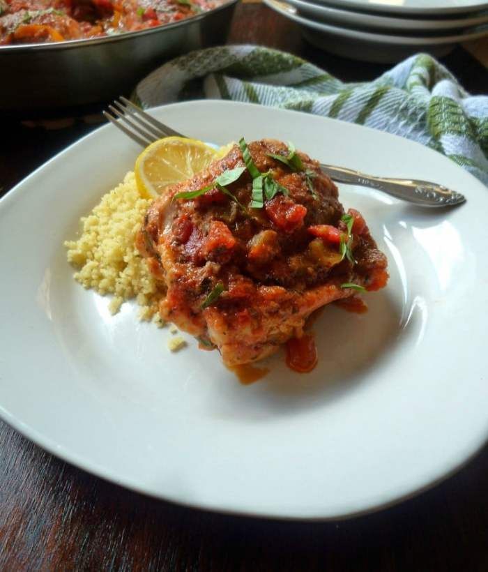 Hunter-Style Chicken {Chicken Cacciatore } looks impressive but really it's so simple and easy to make. All you'll need to make this delicious tasting Hunter-Style Chicken is chicken thighs, onions, chopped bell peppers, tomatoes, green olives, fresh minced garlic, kosher salt, freshly ground pepper, red wine, olive oil, flour, thyme, fresh basil, and a touch of oregano.