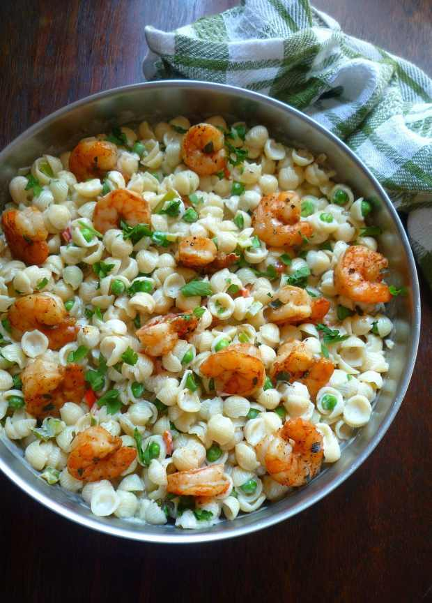 Spicy Shrimp and Annie's Homegrown Shells and White Cheddar is totally delicious and exciting new recipe made with Certified Grass-fed Organic Annie's Homegrown Shells and White Cheddar, Shrimp seasoned to perfection with Cajun Spices, Organic veggies such as peas, red bell peppers, celery, and onions sauteed in olive oil and unsalted butter, smothered in a creamy white cheddar cheese sauce.