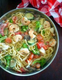 Creamy Linguine with Seafood is a delicious linguine pasta dish combined with gulf shrimp, lump crabmeat, fresh steamed veggies consisting of zucchini, broccoli, carrots, mushrooms, and roasted red sweet peppers covered in a thick creamy Alfredo cheese sauce made from a rich heavy cream, Parmigiano-Reggiano, Romano cheese, garlic, and seasoned to perfection with Italian herbs and spices.