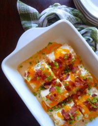 Easy to Make Pierogi Lasagna Rolls are for those of us that do not look forward to spending hours in the kitchen making Old Fashioned Polish Pierogies but enjoy the delicious taste of a homemade pierogi. Traditionally Pierogies are pretty time-consuming being they are made by making homemade dough and wrapping the dough around a savory or even sweet filling; then cooked in salted boiling water.