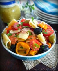 Lemony Italian Pasta Salad is a quintessential salad recipe to have this spring/summer combining Rigatoni pasta noodles, pepperoni, ham, grape tomatoes, red onions, quality black olives, green olives, sliced sweet peppers, Romano cheese, and a delicious homemade lemony Italian Salad Dressing.