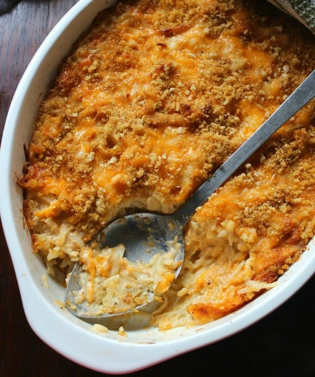 Southern-Style Cheesy Hashbrown Casserole is one of the ultimate comfort food casseroles that I make, this one has absolutely no canned soup, is  made with chunky-style hashbrowns or shredded, deliciously mild cheddar cheese,  white sharp cheddar cheese, heavy cream,  sour cream, minced carrots, chopped onions, and seasoned with Cajun seasoning,
