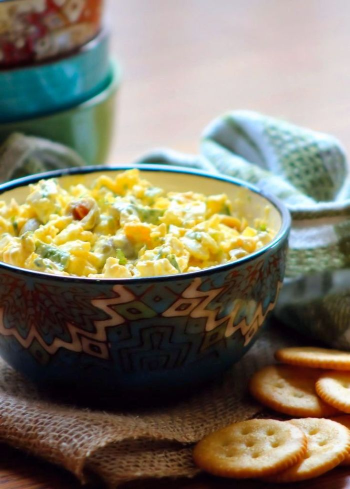 The perfect Southern-Style Egg Salad starts with a blend of creamy and slightly crunchy textures coming together with bright, fresh flavors. It's not even particularly fancy, there are no special secret ingredients just old-fashioned goodness piled on top of rich butter crackers or freshly baked slices of homemade bread.