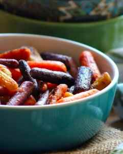 Roasted Rainbow Carrots with Honey Lime are not only gorgeous but colorfully tempting to any organic carrot lover. The slightly different taste of each color these vibrant colored beauties is amazing. This wonderful flavor only intensifies as you slowly roast them in the oven after glazing them with a layer of flavor bursting Honey and Lime Glaze.