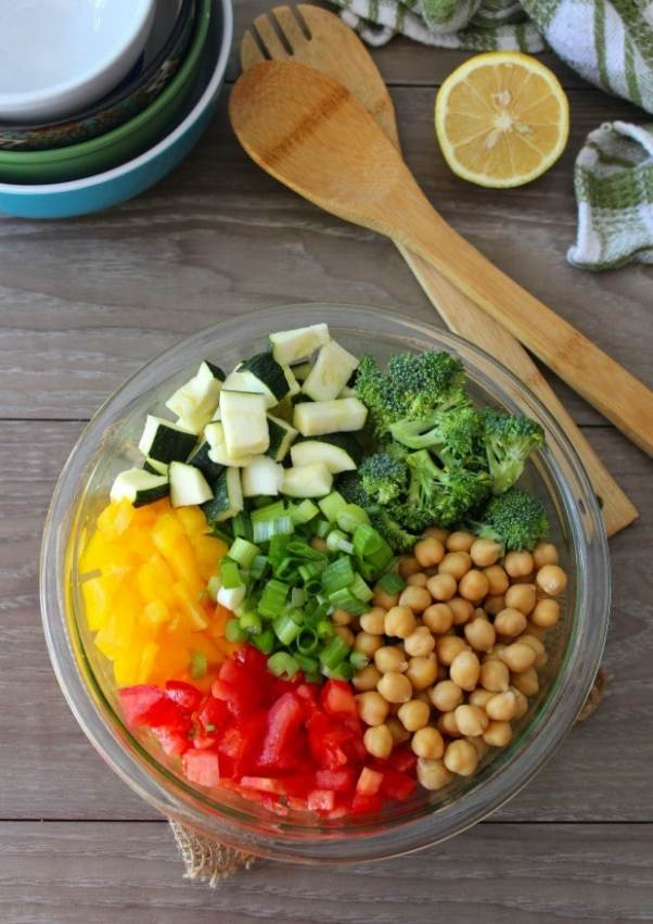 This delicious tasting easy to make Chickpea Salad combines all of my favorite organic garden fresh vegetables in one fabulous easy recipe. The chickpeas are combined with zucchini, vine-ripened tomatoes, sliced green onions, sweet yellow bell peppers, drizzled with a virgin olive oil and lemon dressing.