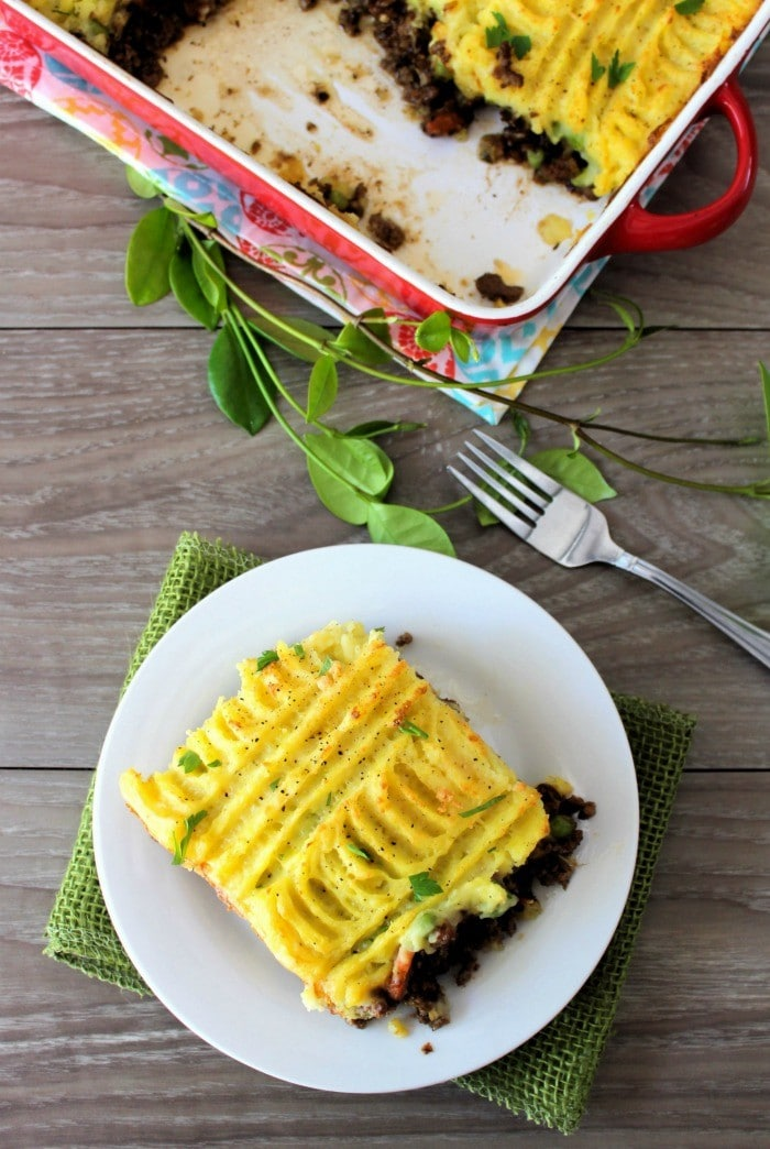 If you're in the mood for a flavorful, hearty, savory comfort-food classic recipe, this Shepherd's Pie – Cottage Pie is going to hit the spot, dead on at dinner. Made with lean ground lamb or beef, fresh organic veggies, and topped with delicious garlic cheddar mashed potatoes, then baked to perfection