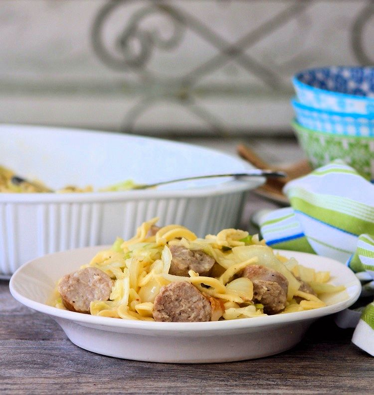 Cabbage Sausage and Kluski is a simple to make, yet, deliciouslyflavorful PennsylvaniaDutch Recipe made from fried green cabbage, lightly browned bratwurst sausages, garlic, onions, butter, and Polish Kluski Noodles that your entire family is sure to love.