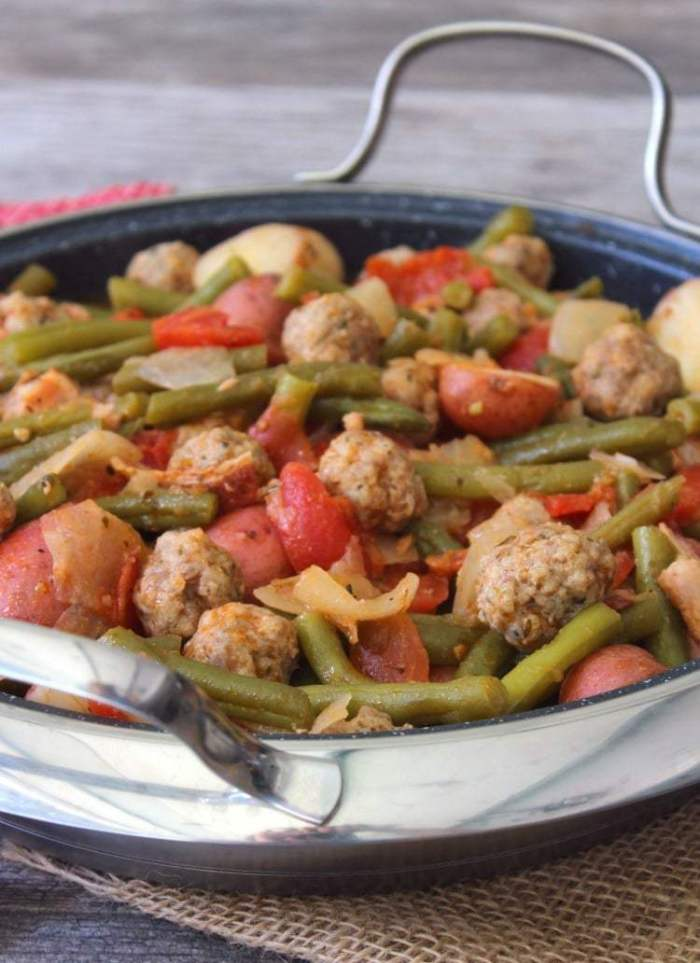 Green Beans Sausage and Potatoes is pure delicious, flavorful,  old-style comfort food at it's finest, made with fresh organic green beans, Italian sausage meatballs, organic small red potatoes, onions, and simmered in a tomato broth.