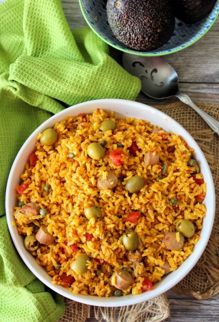 Arroz Con Salchichas aka Rice with Vienna Sausages has for many years been known as comfort food in both Cuban and Puerto Rican households, made distinctly with long grain rice, tomatoes, homemade sofrito, green olives, capers, and Latino spices