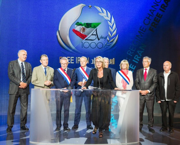 Image: Gilbert Mitterrand, President of France Libertés, standing right Sylvie Fassier, Mayor of Le Pin and co-master of ceremony who takes the microphone addressing the diaspora of Iranian communities at the Free Iran annual rally on 9 July 2016 at Le Bourget, Paris, France. Copyright Siavosh Hosseini | The Media Express 2016.