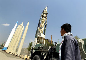 Man looks at Iranian-made missiles at Holy Defence Museum in Tehran