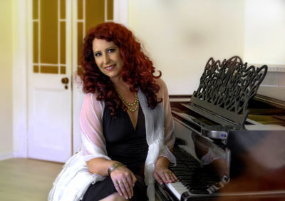 How a classically trained pianist ditched her power suit for a career in the arts