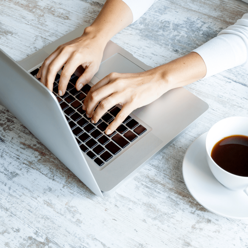 woman hands on laptop   7 Membership Sites for Entrepreneurs To Inspire Your Own