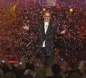 Elton John the singer as confetti rains down