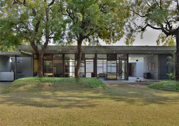 11--view-of-the-rear-garden-side-facade-with-existing-neem-trees