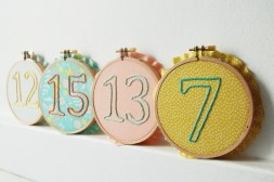 Table numbers in embroidery hoops by merriweathercouncil on etsy.com