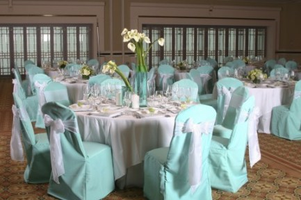 A reception set up in Tiffany blue and white