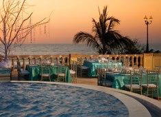 Destination wedding reception in emerald colours