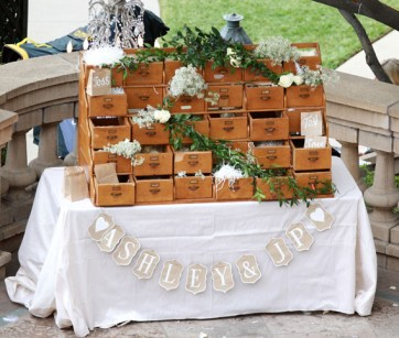 Guests filled brown paper bags with rose petals and confetti to toss on Ashley Hebert and JP Rosenbaum after the ceremony
