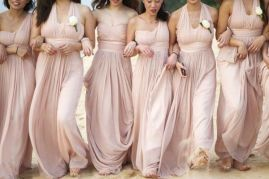 Bridesmaids in blush-coloured dresses