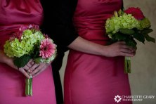 Bridesmaids in fuchsia with green and fuchsia bouquets