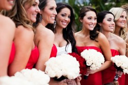 Bridesmaids in red with white bouquets