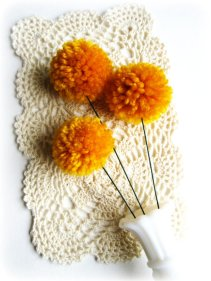 Yarn pompom flowers, by WildPoppyShoppe on etsy.com