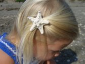 Flower girl starfish hair clip, by sandnsurfcreations on etsy.com