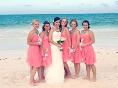 Bridesmaids in coral dresses with aqua necklaces {via thatsmineboutique.blogspot.com}