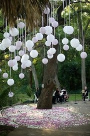 Hang balloons in a tree with a marble inside {via photosmashing.blogspot.com}