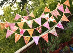 Pink and orange bunting, by StarlitNestGifts on etsy.com