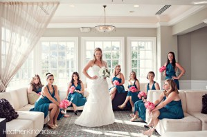 Bridesmaids in teal with pink bouquets {via heatherkincaid.com}