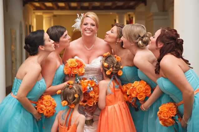 Bridesmaids and flower girls in turquoise and orange {via marrymetampabay.com}