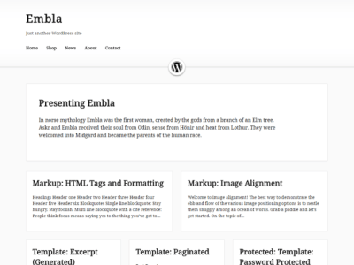 Embla has a light grey body background and a header and content area in white. The first post is full width while the rest of the posts on the blog are displayed in two and three columns. There is a icon separating the header and content area.