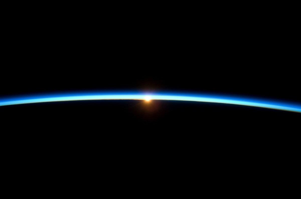 sunrise through earth atmosphere