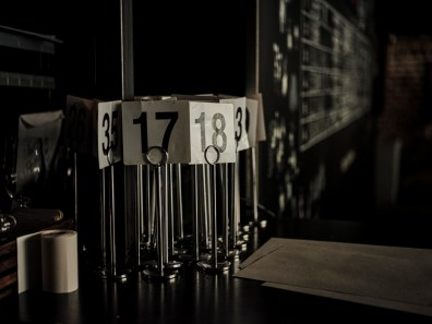 Table numbers sit unused