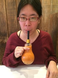 I don't look it but I'm ecstatic to be drinking Thai milk tea out of the lightbulb cup which I kept :D