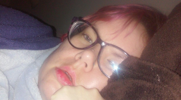 woman wearing glasses lying on pillow