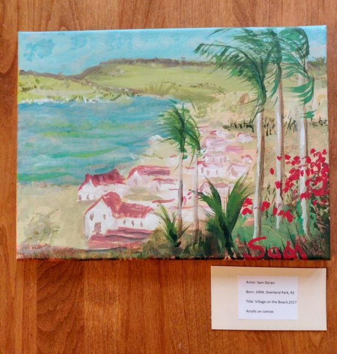 Sam Doran's painting, white houses with red roofs b a lake surounded by mountains and palm trees are closest to observer