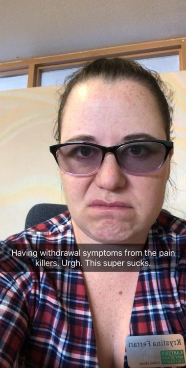 woman wearing a plaid shirt and tinted glasses frowning with a caption over the picture that says 'having withdrawal symptoms from the painkillers. ugh. this super sucks'