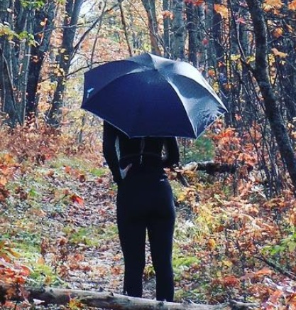 the author with her UV umbrella in the woods