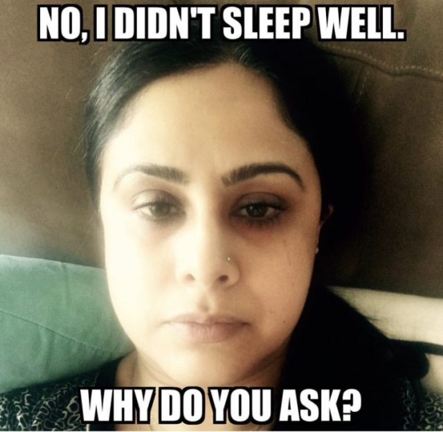 woman sitting up in bed with dark circles around her eyes and a caption that says, 'No, I didn't sleep well. why do you ask?""