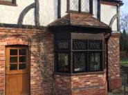 Black aluminium timber fix windows