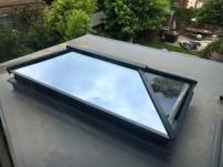 A contemporary aluminium roof lantern in anthracite grey aluminium