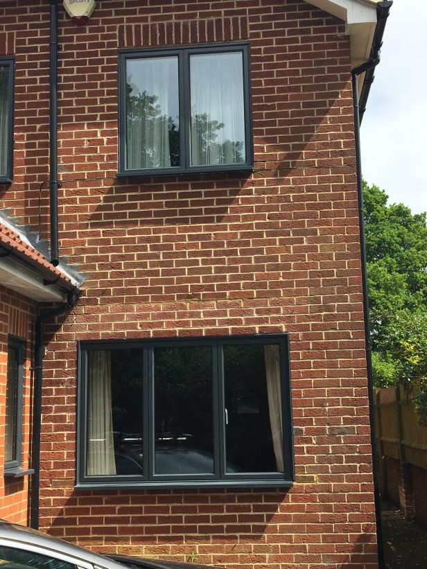 Aluminium windows in anthracite grey. Dummy sashed to create equal sightlines