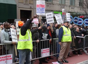 Hundreds of workers rally March 28 in New York to back Spectrum cable workers, members of International Brotherhood of Electrical Workers, on strike for a year against concessions.