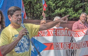 It was working people, not the government who cleared roads, fixed schools after hurricane, Rafael Feliciano, Federation of Puerto Rican Teachers, told June 2 protest in front of U.N.